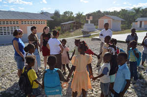Some team members playing a Haitian game