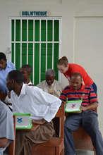 A team member helping a teacher with the internet