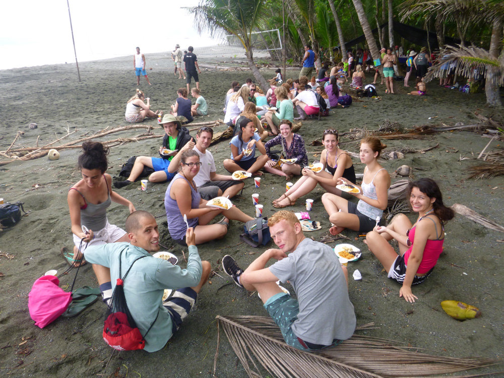 Volunteers eating lunch after cleaning the beach