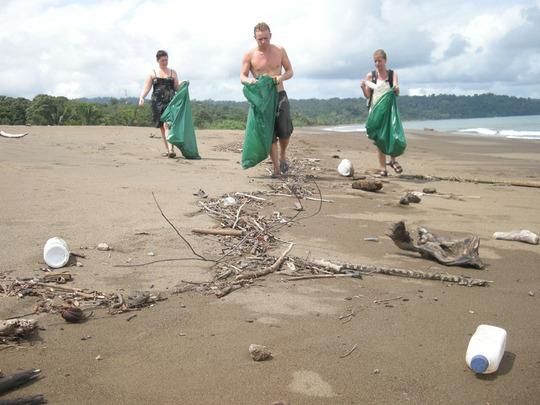 Cleaning the beach in Drake Bay