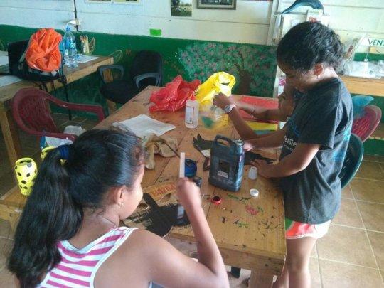children working on their costumes
