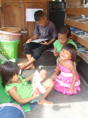 Children reading books in the Mobile Library