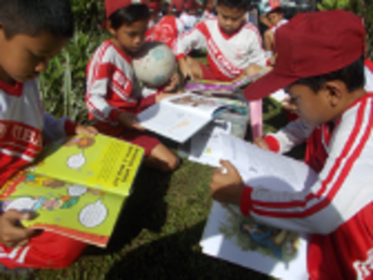 Children Read in the Box of Books Program