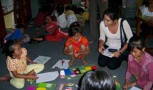 Jacqueline observes the children's activity