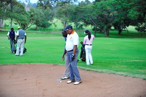 A blind golf player with his guide.