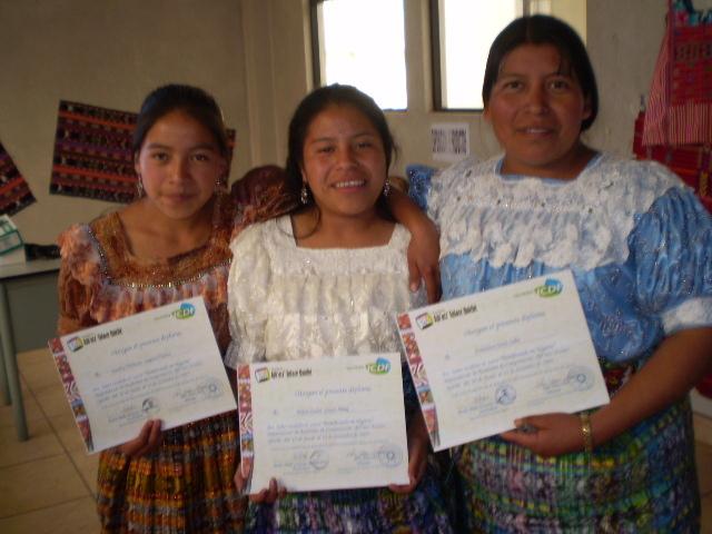 Girls receiving diplomas