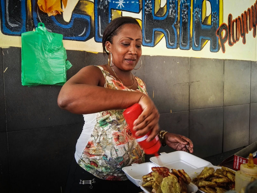 Local woman managing a food stand