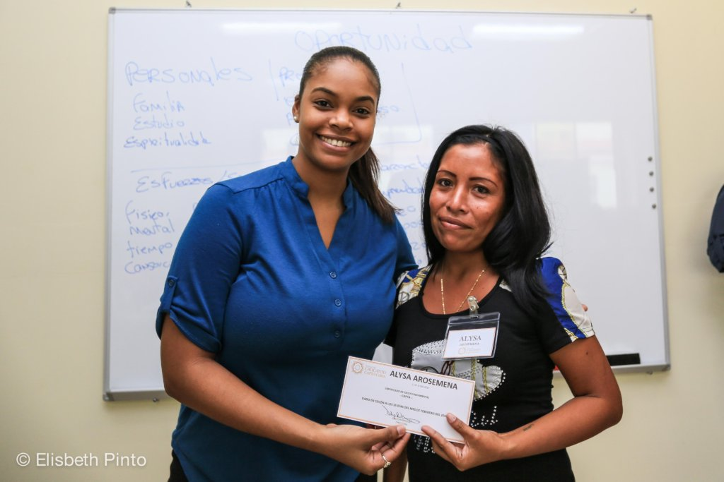 The Executive Director providing scholarships