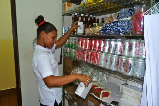 Diana organizing the store-closet.