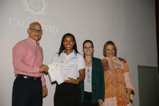 She's happy receiving her certificate