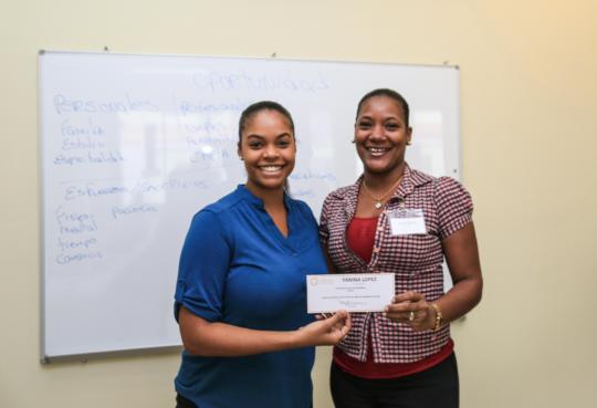 Receiving her scholarship.