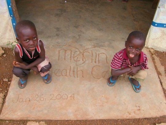 Two Boys Outside Merlin Health Clinic