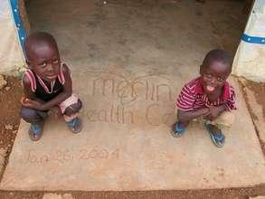 Two Boys Outside Merlin Health Clinic