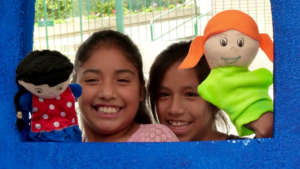 Girls staging with puppets the risks of CDW