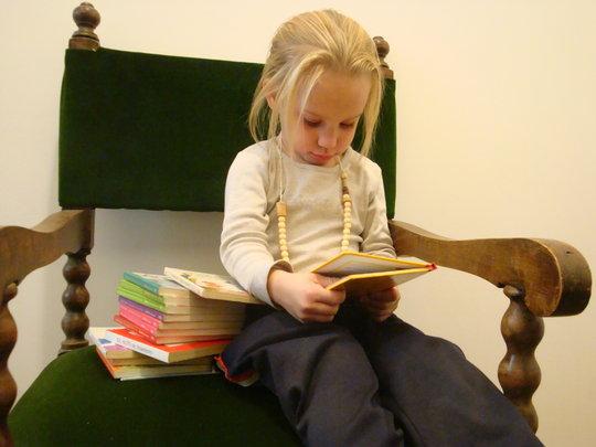little deaf girl reading