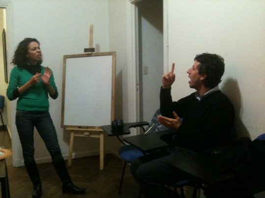 LSA interpreter with deaf reader