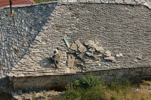 Traditional method used to repair stone roof