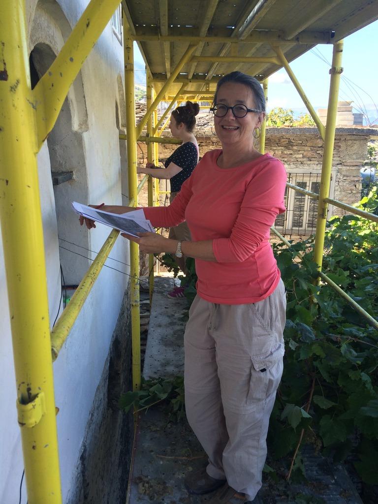 AiP volunteers document damaged wall paintings