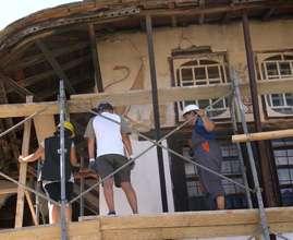 Volunteers begin repair of lime plaster wall
