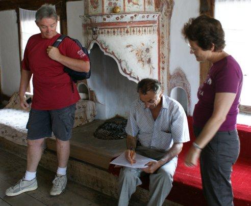 Visitors from Australia tour house w/ Mr. Skenduli
