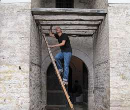 Volunteer records condition under the arched entry