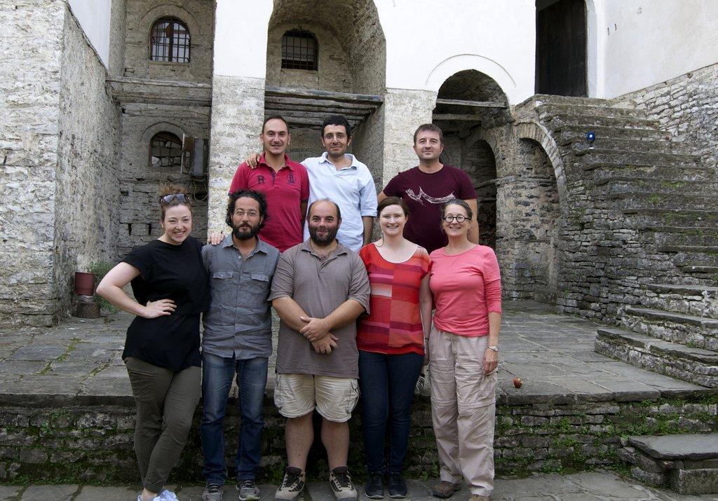 Part of volunteer team in Skenuli house courtyard