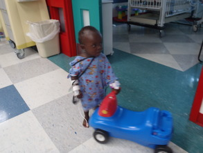 Luke taking his first steps in the hospital