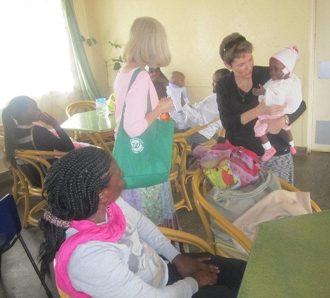 Team members interact with patients
