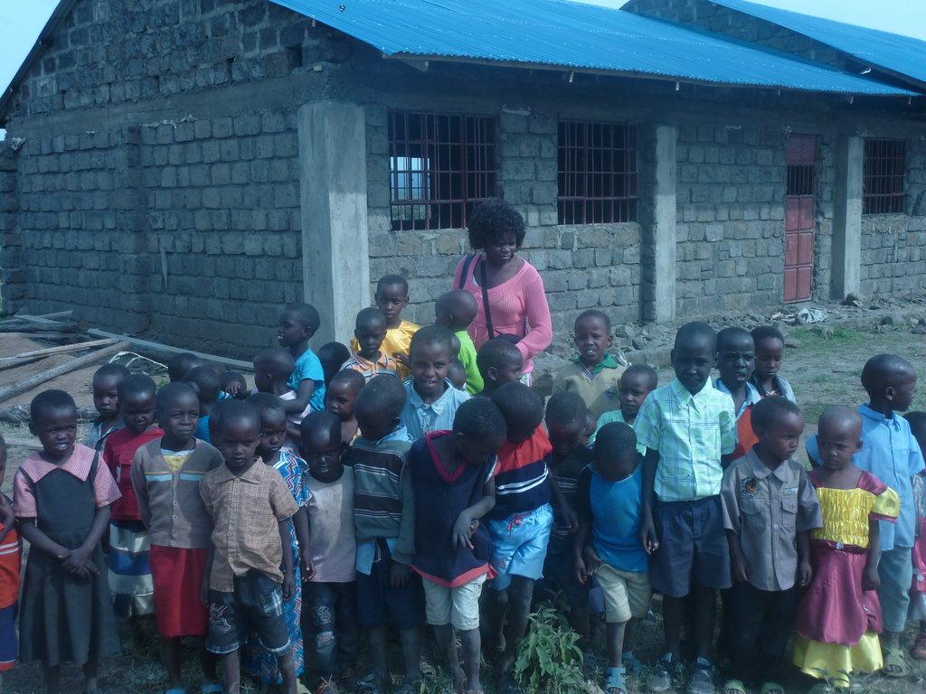 Teacher and children at school - beneficiaries