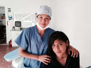 Adela at Burn Center giving Dental Treatment