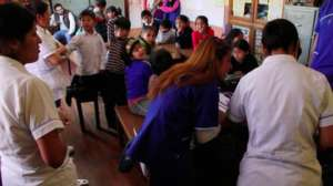 Classroom of children learning dental hygiene
