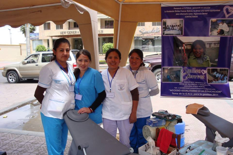 Dr. Apata in blue with Dental Hygienists