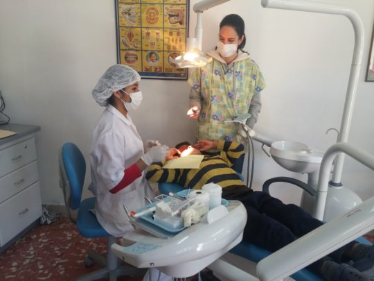 Vania treating a child age 8 with Dr. Ricci
