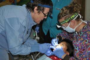 Rosie Bellert with student helping patient