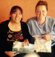 Sonja with Katie receiving dental supplies