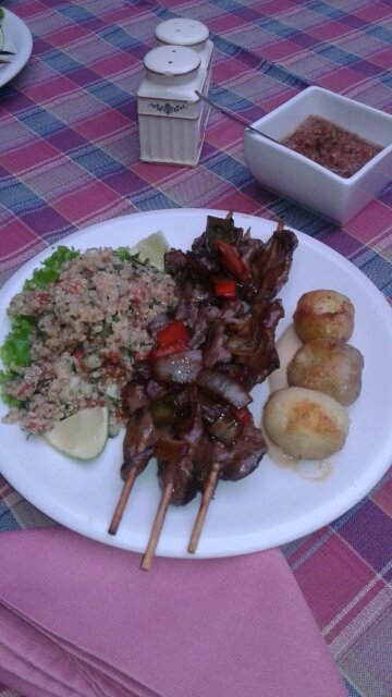 Dish of quinoa, barbecued heart & peanut potatoes