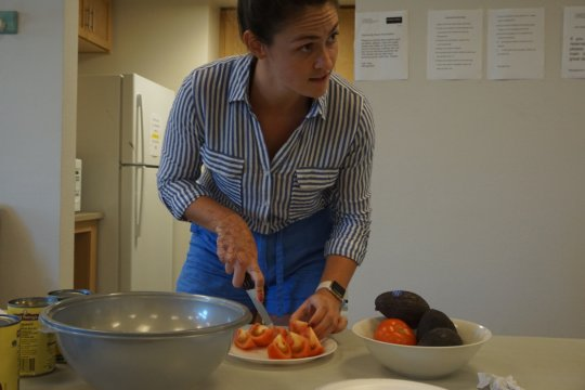 Danielle preparing and teaching about healthy food