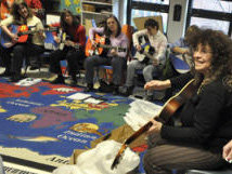 Teachers strum & sing at GITC-Lee, MA
