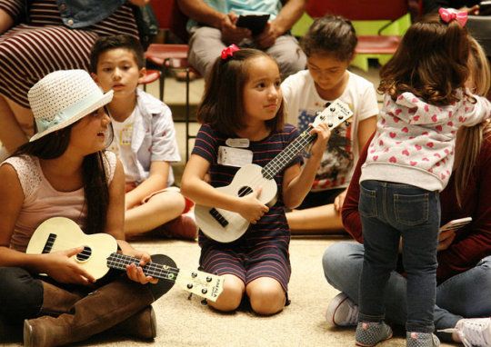Children lead songs for their families in June!