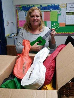 Kim Smith receives ukuleles at Dewey Elementary