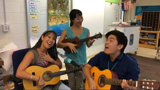 Teachers practice water songs at Pomaikai