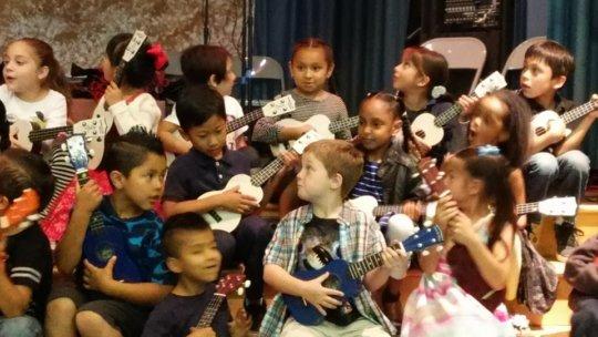 Kindergarteners strum, sing and learn!