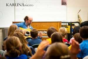 George Winston visits a GITC school on tour