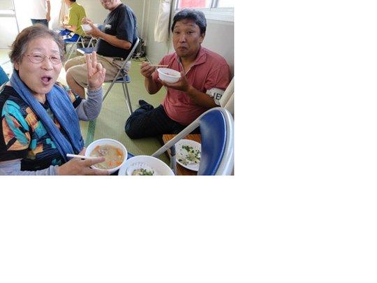 Ms. Sanjo, talks cheerfully with JEN Staff