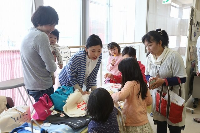 Women sell their handmade goods