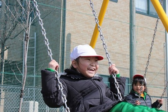 A student enjoys the new playground.