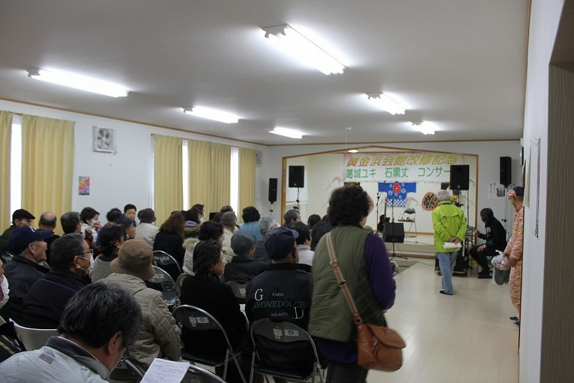 A concert is held at the new community house.