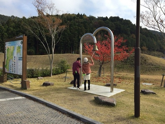 Couple Ringing the Bell of Happiness