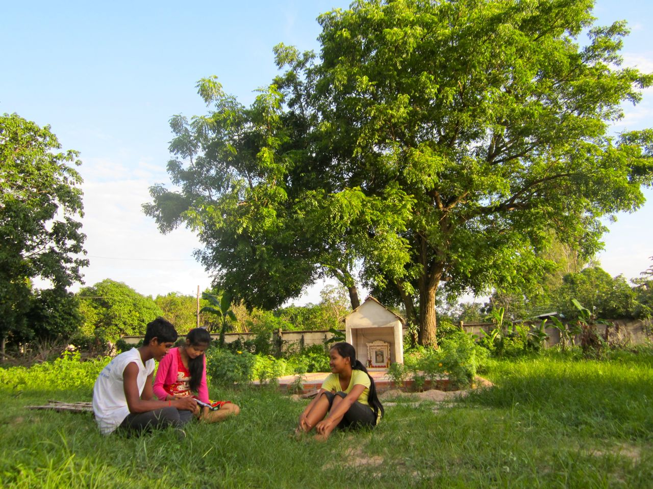 Studying can be done any where but its always nice to have friends to join you.  These are some of our children getting ready for their ninth grade exams while still enjoying the beautiful day in the back yard of our children