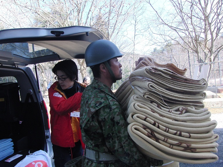 Japan Self Defense Force helps unload relief items